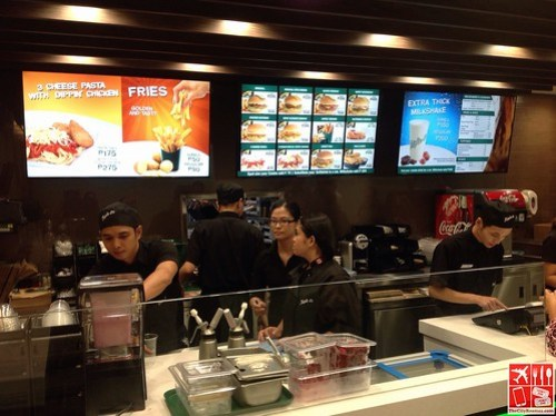 The crews at the counter of Triple-O's by White Spot