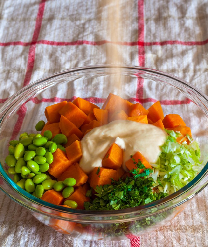 Thai sweet potato salad dressing pour