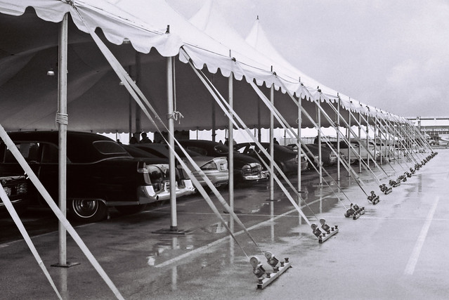 Old cars under an awning