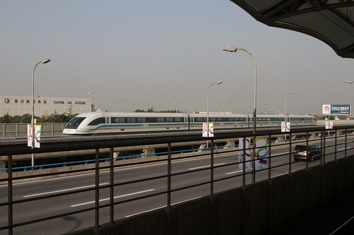 Maglev train speeds past Haitiansan Road Station at 300 km/h