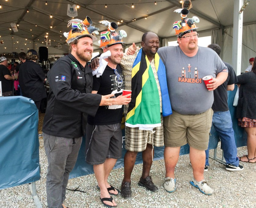 Competitor from Tanzania (with Tanzania flag) Poses for a Photo at World Food Championships Blogger Summit, Orange Beach, Ala., Nov. 7 - 9, 2016.
