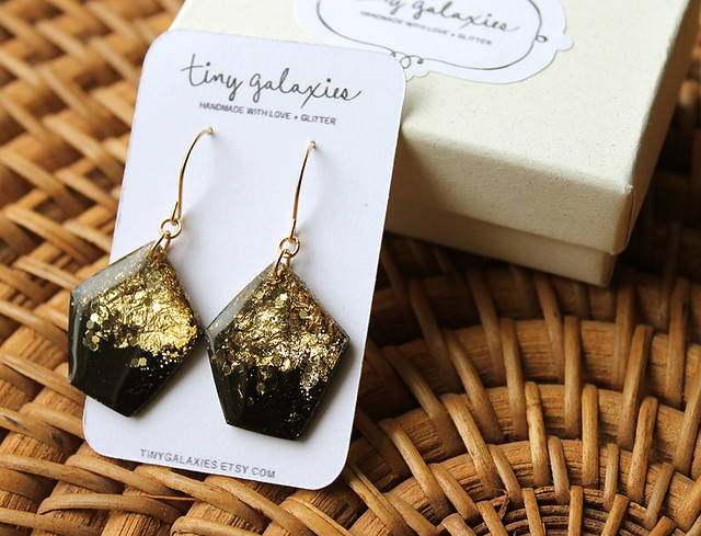 Black and gold big dangly earrings by tiny galaxies