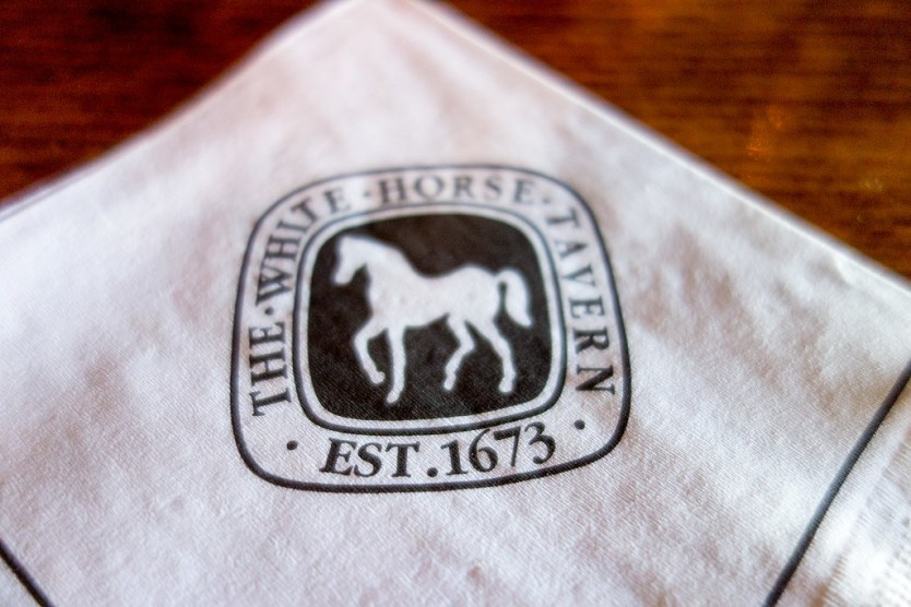 The emblem on a napkin at the White Horse Tavern.