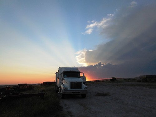 Truck parked at sunset