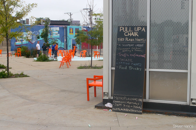 Nushu's orange chairs at the Logan Square Blue Line station