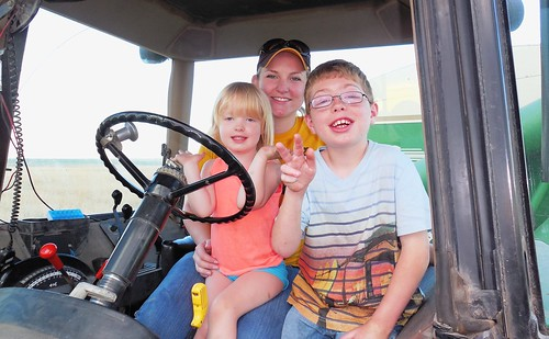 Ava, Zach, and Megan in the tractor