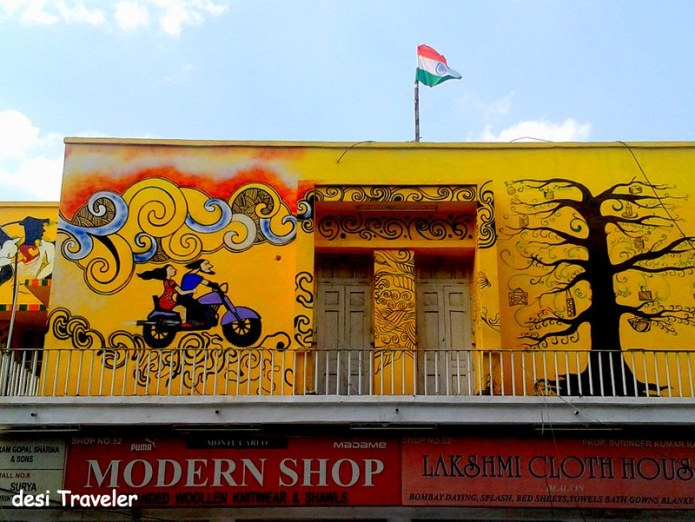 A couple on Bike on Delhi Streets Tricolor Flag Tree with gifts