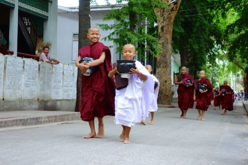 Monks and novices ready for lunch, Myanmar