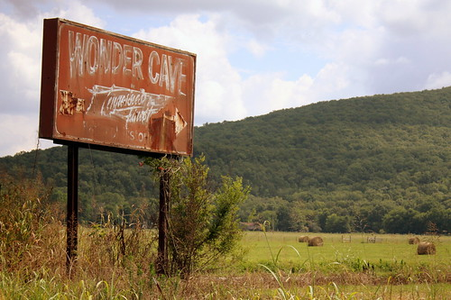 Wonder Cave, an old sign pointing to