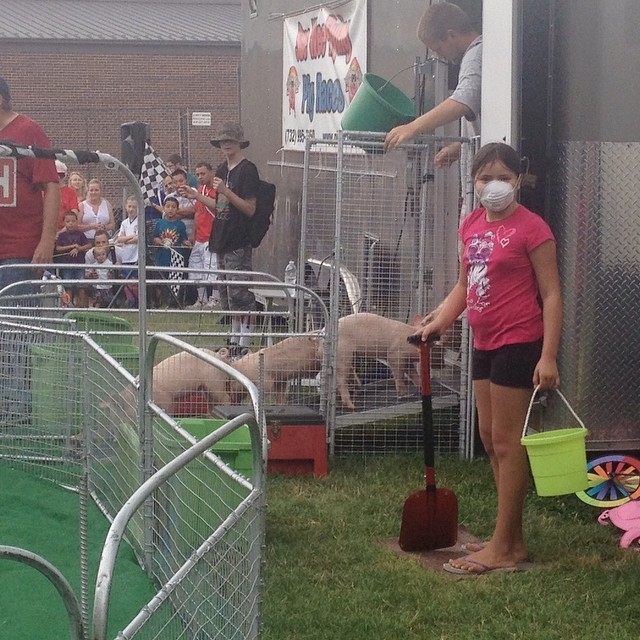 Maya was chosen to be the track official and safety coordinator for the pig races at Arlington County Fair. So fun!