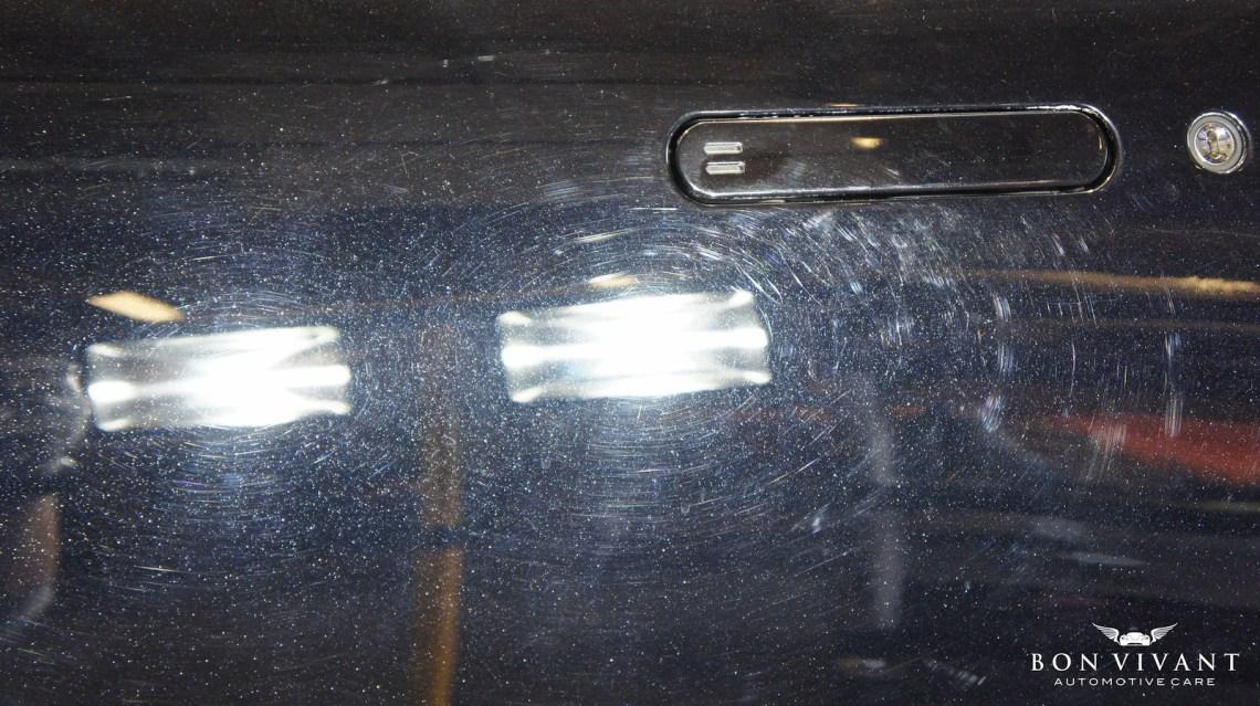 Aston Martin door before compounding swirls
