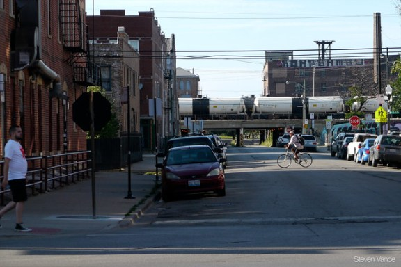 Oil train running on BNSF tracks through Pilsen in Chicago