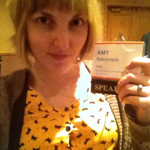 Wearing a cute new dress, publicizing my relatively new name. Presenting in an hour!