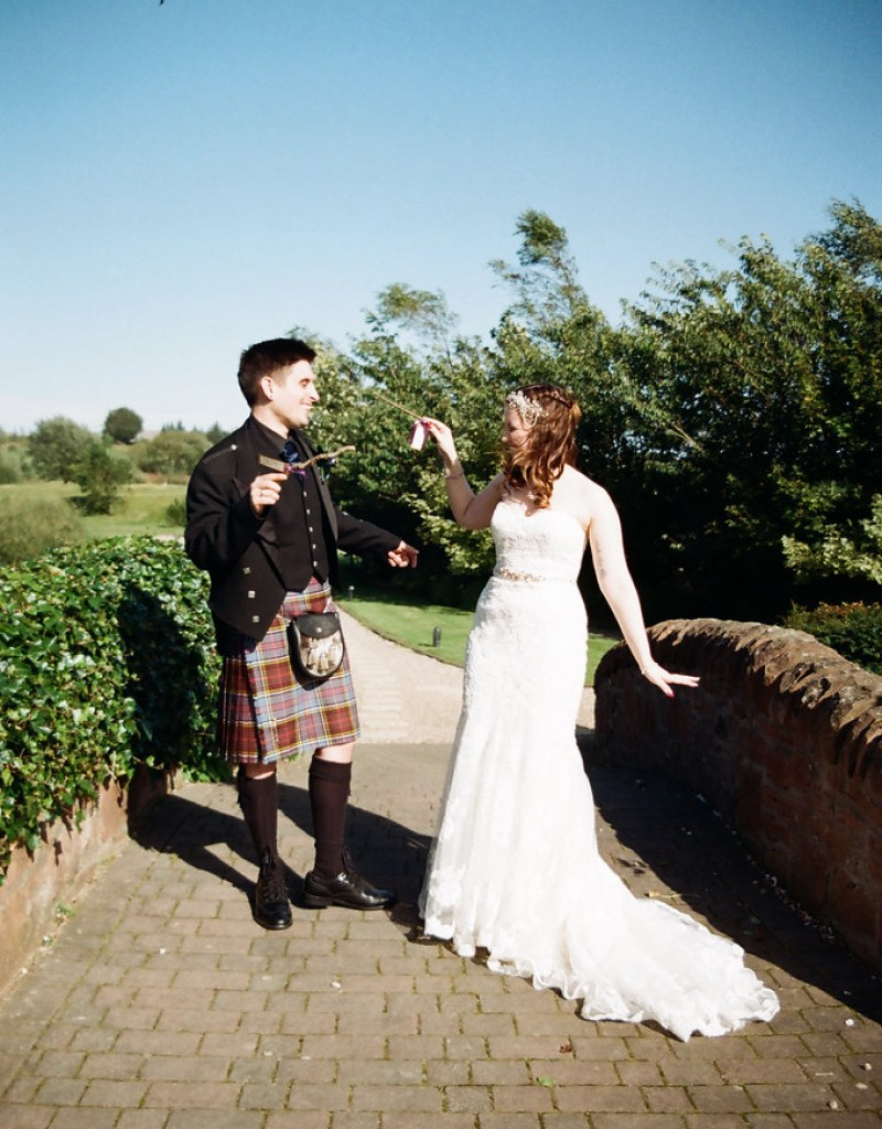 Wand duel bride and groom at this Scottish Harry Potter wedding on @offbeatbride