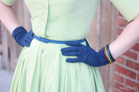 blue gloves, bakelite bangles, and belt detail