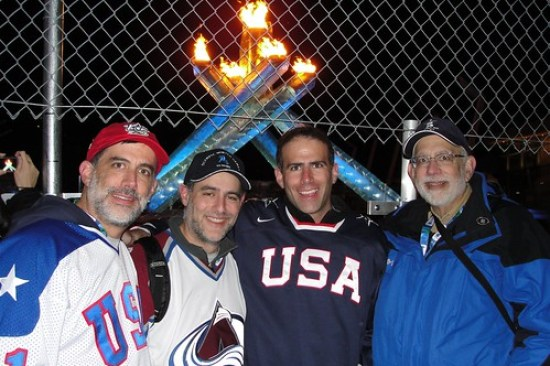 Team USA fans line up for a photo before the Olympic Cauldron