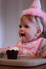 Juliet enjoying her first birthday cupcake