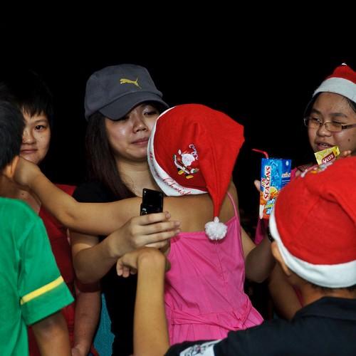 Children at a Christmas dinner at Bukit Harapan.