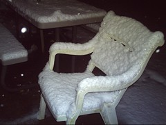 Chair blanketed in snow