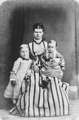 Mother and two children posing for a portrait,...