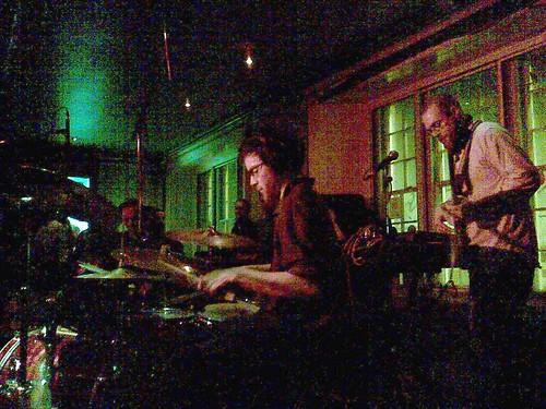 Half of the Joe Acheson Quartet. In the semi-dark