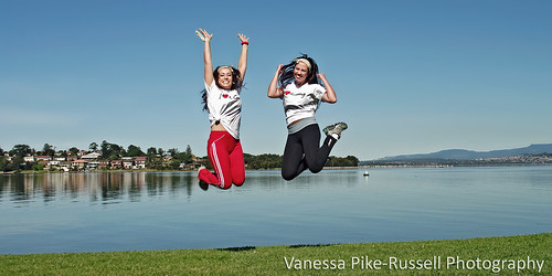 Claudia Blackmore and Josie Shanahan jump for joy after riding 40km around the lake as part of team HOT WHEELS in the Ride Around The Lake charity bike ride event this weekend