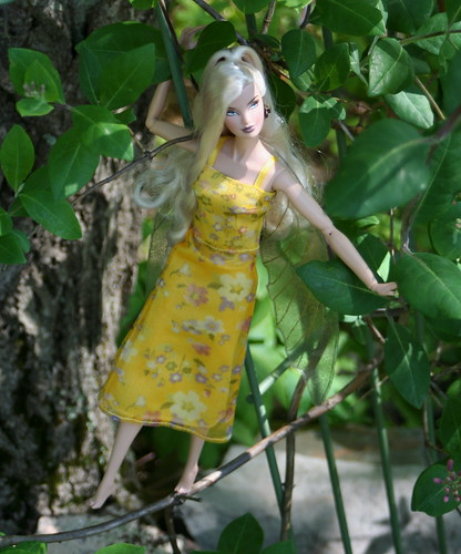 A Faerie Among The Honeysuckle Vines