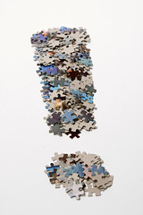 Fat exclamation mark made from jigsaw puzzle p...