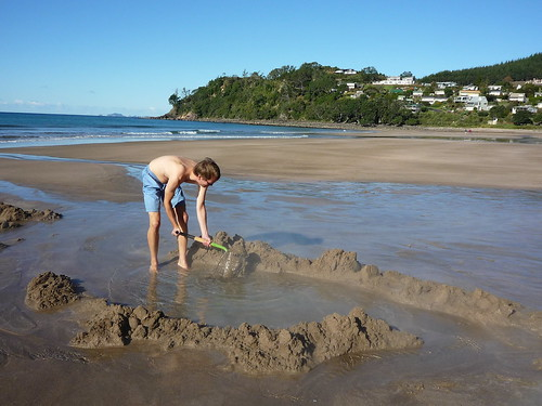 Digging a hot pool at Hot Water Beach, Coromandel Peninsula