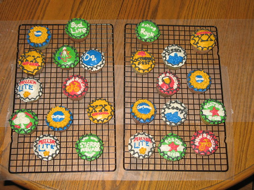 cupcakes decorated to look like various bottle caps