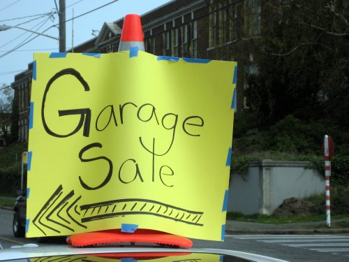 Garage sale sign on car