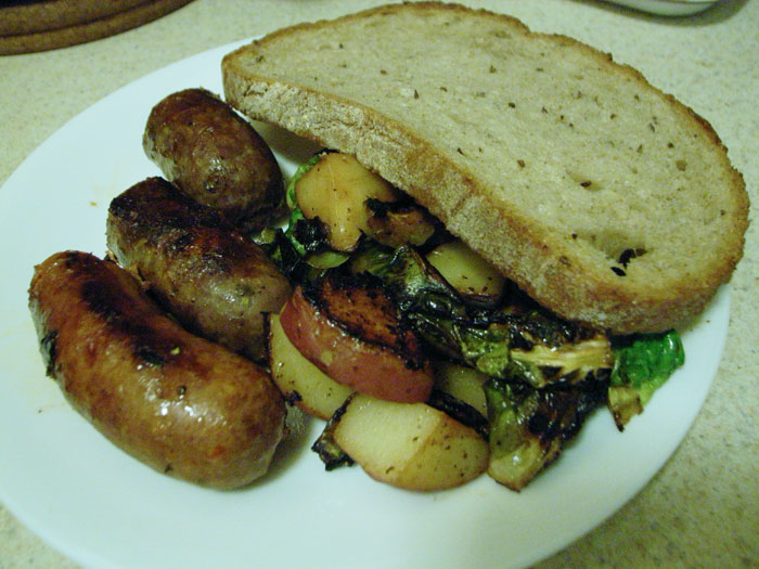Trio of sausages with potatoes/brussel sprouts/bread