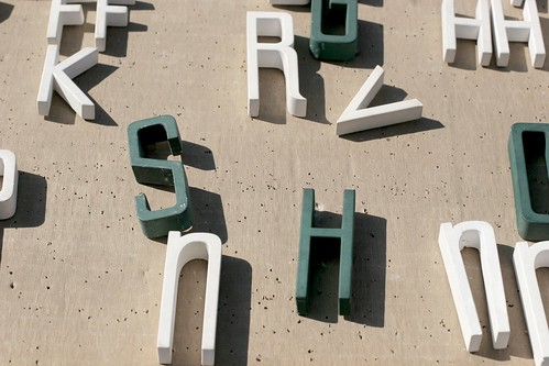 Letters, white and green