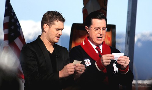 Michael Bublé and Stephen Colbert singing their respective national anthems.