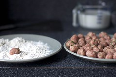 tiny meatballs, one dredged in flour