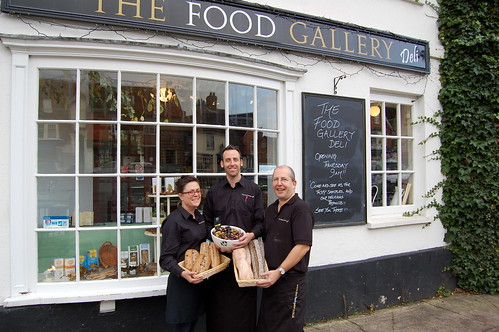 Elaine and Andy Nobbs with Bob Holman at The Food Gallery Deli.