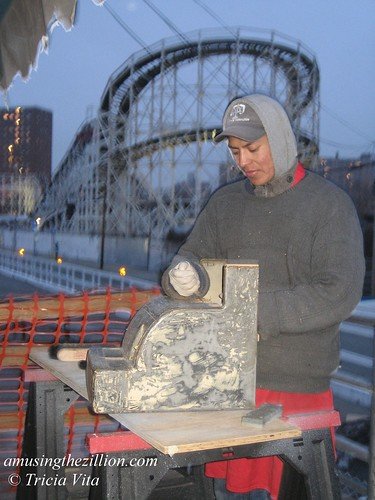 Rafael Refurbishing the Cash Register at Paul's Daughter in Coney Island. Photo © Tricia Vita/me-myself-i via flickr