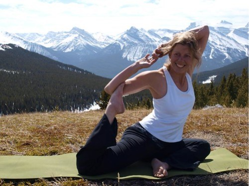 Martha of Martha's Heli-Hikes, leading yoga in the Rockies