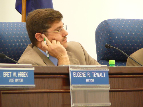 """Tom Sayre may be calculating the number of votes - his - council opposition to the FRLP rezoning had prior to what was a 5-1 vote of approval of the long-negotiated rezoning - or maybe he was just saying """"high"""" to his favorite photographer."""