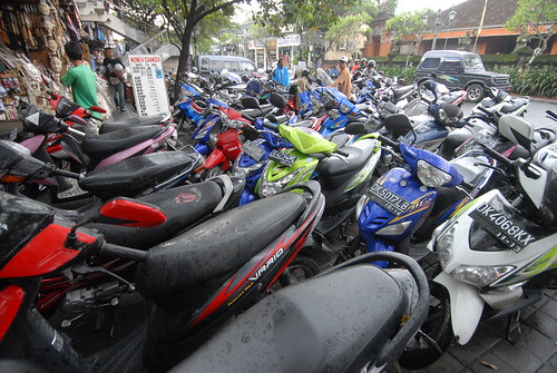 Indonesia's ubiquitous motorbikes line the streets of Ubud.