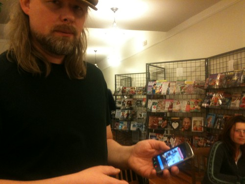 Tomi shows me his mobcomics app