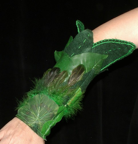 sleeve of ghreen leaves and green feathers