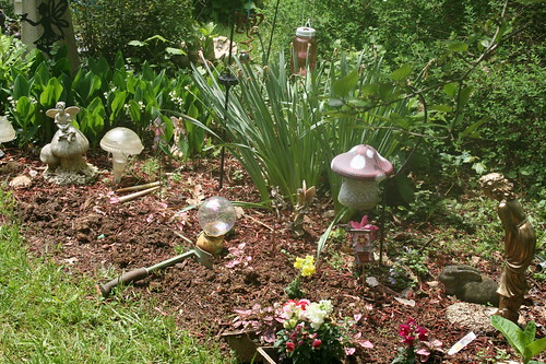 Planting flowers in the fairy garden