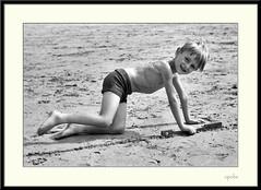 Scrawny kid on beach!