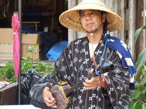 Man playing the sanshin in Okinawa