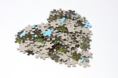 Tilted heart made of lots of jigsaw puzzle pieces