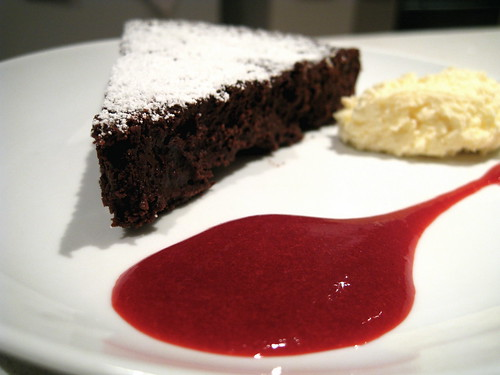 Chocolate Truffle Oblivion Torte with Raspberry Sauce and whipped cream