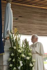 Pope Benedict XVI prays in front of the image ...