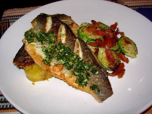 Pan-seared branzino with Meyer lemon gremolata, fondant potatoes with saffron, Brussels sprouts with double-smoked bacon