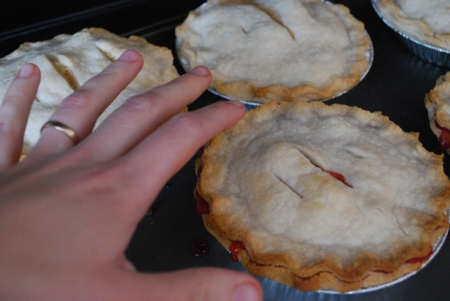 baked pies with hand